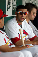 Alex Castellanos (18) of the Springfield Cardinals talks with teammates in the dugout during a game against the Tulsa Drillers at Hammons Field on June 27, 2011 in Springfield, Missouri. (David Welker / Four Seam Images)