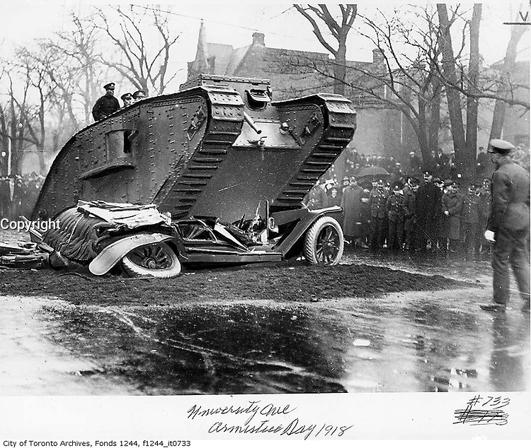 1918 File Photo - Toronto, ON, CANADA - tank crushing a car in victory bond drive on University avenue,