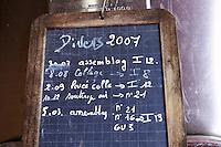 Chalk board on fermentation tanks with vinification notes chateau lestrille bordeaux france
