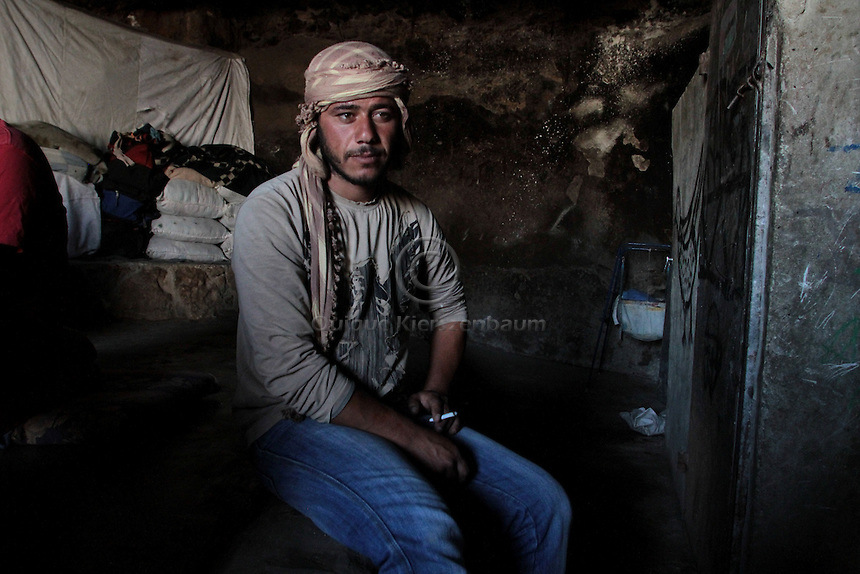 """Mohammed Jabareen, 25 is seen in the cave he lives with his family in Jenba a Palestinian town of 50 families seats in an area called by the IDF as """"Firing Zone 918"""" and is located in the southern Hebron hills near the town of Yatta.  Spread over 30,000 dunams, it includes twelve Palestinian villages.  According to OCHA figures, 1,622 people lived in the area in 2010, and according to local residents the number of inhabitants currently stands at about 1,800. For over a decade, the residents of twelve uniquely traditional Palestinian villages in the area of Masafer-Yatta in the south Hebron hills have lived under the constant threat of demolition, evacuation, and dispossession.<br /> The State's insistence on evacuation of Firing Zone 918 in part or in whole, if acceptance by the HCJ, might result in an immediate humanitarian disaster for almost two thousand souls, the destruction of villages, and the eradication of a remarkable way of life that has endured for centuries. Photo by Quique Kierszenbaum."""