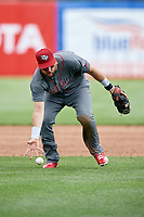 Lehigh Valley IronPigs third baseman Trevor Plouffe (19) fields a ground ball during a game against the Syracuse Chiefs on May 20, 2018 at NBT Bank Stadium in Syracuse, New York.  Lehigh Valley defeated Syracuse 5-2.  (Mike Janes/Four Seam Images)