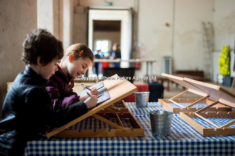 Saturday 18 February 2017<br />Pictured:<br />Re: Sign a Slate' activity takes place in the riding school at Tredegar House, Newport, South Wales.  Sign a Slate is a fundraising campaign to support roof repairs where visitors can purchase a slate and write a chalk message on it before it goes on the roof.