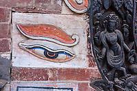 Bhaktapur, Nepal.  Eye of the Buddha in a Buddhist Shrine Adjacent to the Nyatapola Hindu Temple.