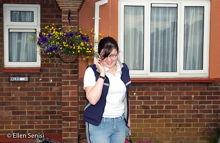 MR / Radley, Abingdon, Oxfordshire, England.Young woman (21) uses cellphone at home..MR: Web7.©Ellen B. Senisi