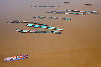 Fishing barges and container ships on the Yangtze River. /Felix Features