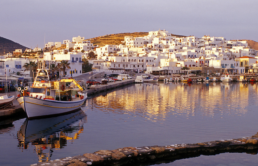 Paros, Greek Islands, Naoussa, Cyclades, Greece, Europe, Fishing boats docked in Naoussa Harbor on Paros Island on the Aegean Sea.