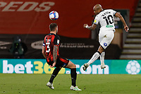 Andre Ayew of Swansea City (R) heads the ball over Steve Cook of Bournemouth during the Sky Bet Championship match between Bournemouth and Swansea City at the Viatlity Stadium, Bournemouth, England, UK. Tuesday 16 March 2021