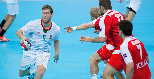 08 AUG 2012 - LONDON, GBR - Gabor Csaszar (HUN) of Hungary (left) looks for a way through the Iceland defence during the men's London 2012 Olympic Games quarter final match at the Basketball Arena in the Olympic Park, in Stratford, London, Great Britain .(PHOTO (C) 2012 NIGEL FARROW)
