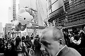 New York, New York<br /> November 26, 2009<br /> USA<br /> <br /> The Macy's Thanksgiving Day Parade in mid-town Manhattan, as Hello Kitty, and other children's cartoon character balloons float through the skyscrapers on 6th Avenue and 42nd Street. Crowds gather to mark the beginning of the Christmas season.