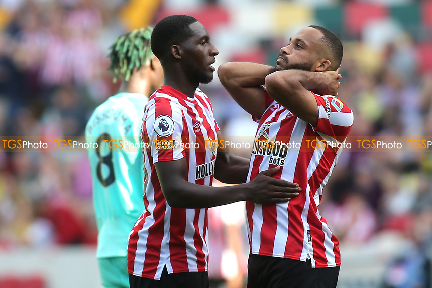 Shandon Baptiste consoles Bryan Mbeumo after the Brentford striker, missed an opportunity to score during Brentford vs Brighton & Hove Albion, Premier League Football at the Brentford Community Stadium on 11th September 2021