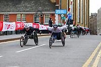 3rd October 2021; London, England: The Virgin Money 2021 London Marathon: John Charles Smith of Great Britain and Patrick Monahan of Ireland crossing Narrow Street Swing Bridge, Limehouse Basin between mile 14 and 15.