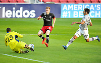 WASHINGTON, DC - NOVEMBER 8: Clement Diop #23 of Montreal Impact saves a shot on goal from Julian Gressel #31 of D.C. United during a game between Montreal Impact and D.C. United at Audi Field on November 8, 2020 in Washington, DC.