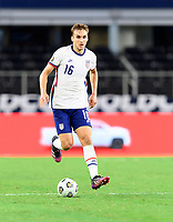DALLAS, TX - JULY 25: James Sands #16 of the United States brings the ball up the field during a game between Jamaica and USMNT at AT&T Stadium on July 25, 2021 in Dallas, Texas.