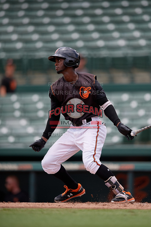 GCL Orioles Carlos Baez (13) bats during a Gulf Coast League game against the GCL Braves on August 5, 2019 at Ed Smith Stadium in Sarasota, Florida.  GCL Orioles defeated the GCL Braves 4-3 in the second game of a doubleheader.  (Mike Janes/Four Seam Images)
