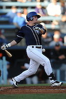 Asheville Tourists first baseman Tyler Massey #5 swings at a pitch during a game between the Delmarva Shorebirds and the Asheville Tourists at McCormick Field, Asheville, North Carolina April 7, 2012. The Tourists won game one of a double header  8-4  (Tony Farlow/Four Seam Images)..