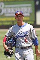 Jaime Pedroza  #6 of the Chattanooga Lookouts carrying his gear to the dugout before a game against the Carolina Mudcats on May 9, 2010 in Zebulon, NC.