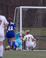 Boston College forward Stephanie Wirth (22) scores on Hofstra University goalkeeper Emily Morphitis (1). Boston College defeated Hofstra University, 3-1, in second round NCAA tournament match at Newton Soccer Field, Newton, MA.