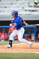Arnaldo Berrios (13) of the Kingsport Mets follows through on his swing against the Greeneville Astros at Hunter Wright Stadium on July 7, 2015 in Kingsport, Tennessee.  The Mets defeated the Astros 6-4. (Brian Westerholt/Four Seam Images)