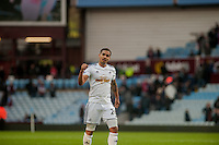 BIRMINGHAM, ENGLAND - MARCH 21: Kyle Naughton of Swansea City   applauds fans  during the Barclays Premier League match between Aston Villa and Swansea City at Villa Park on March 21, 2015 in Birmingham, England. (Photo by Athena Pictures/Getty Images)