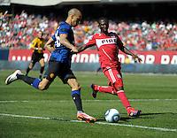 Chicago Fire midfielder Patrick Nyarko (14) defends Manchester United midfielder Gabriel Obertan (26).   Manchester United defeated the Chicago Fire 3-1 at Soldier Field in Chicago, IL on July 23, 2011.