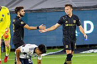 LOS ANGELES, CA - SEPTEMBER 23: Danny Musovski #16 of the Los Angeles football club celebrates a goal with team mate Diego Rossi #9 during a game between Vancouver Whitecaps and Los Angeles FC at Banc of California Stadium on September 23, 2020 in Los Angeles, California.