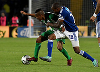 BOGOTÁ - COLOMBIA, 11-01-2019: Jair Palacios (Der.) jugador de Millonarios disputa el balón con Jean Lucas Rivera (Izq.) jugador de Atlético Nacional, durante partido entre Millonarios y Atlético Nacional, por el Torneo Fox Sports 2019, jugado en el estadio Nemesio Camacho El Campin de la ciudad de Bogotá. / Jair Palacios (R) player of Millonarios vies for the ball with Jean Lucas Rivera (L) during a match between Millonarios y Atletico Nacional, for the Fox Sports Tournament 2019, played at the Nemesio Camacho El Campin stadium in the city of Bogota. Photo: VizzorImage / Luis Ramírez / Staff.