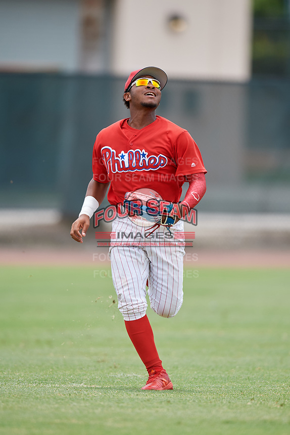 GCL Phillies East left fielder Jose Rivera (28) tracks a fly ball during a game against the GCL Blue Jays on August 10, 2018 at Carpenter Complex in Clearwater, Florida.  GCL Blue Jays defeated GCL Phillies East 8-3.  (Mike Janes/Four Seam Images)
