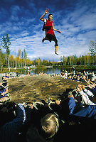 A demonstration of the Native Alaskan tradition of the blanket toss. Alaska Native Heritage Cultural Center, Anchorage, Alaska.