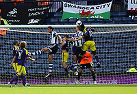 Pictured: Jonas Olsson (C) and Gareth McAuley (2nd R) of West Brom fails to score with a header, they are challenged by Ben Davies and Wilfried Bony of Swansea. Sunday 01 September 2013<br /> Re: Barclay's Premier League, West Bromwich Albion v Swansea City FC at The Hawthorns, Birmingham, UK.