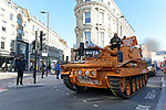 James Haskell drives an orange tank into London to protest against the closure of gyms