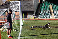 Pictured: Goalkeeper Joe Day lies on the ground. Thursday 18 January 2018<br /> Re: Players and staff of Newport County Football Club prepare at Newport Stadium, for their FA Cup game against Tottenham Hotspur in Wales, UK