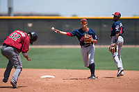 Cleveland Indians shortstop Tyler Freeman (7) makes a throw to first base to complete a double play during an Extended Spring Training game against the Arizona Diamondbacks at the Cleveland Indians Training Complex on May 27, 2018 in Goodyear, Arizona. (Zachary Lucy/Four Seam Images)