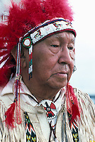 Portrait of Elderly Native American Indian Chief wearing Traditional Ceremonial Headdress and Regalia at Pow Wow, BC, British Columbia, Canada (No Model Release Available)