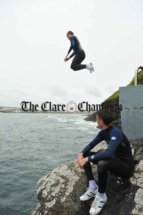 The absence of diving boards at Newfoundout Kilkee wasn't enough to deter some young holidaymakers from partaking in their usual water activities. Photograph  by John Kelly.