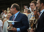 June 13, 2015 Ahmed Zayat of Zayat Stables holds the Triple Crown winner's trophy for American Pharoah, who won the 2015 running of the first jewel of the Triple Crown at Churchill Downs. Also pictured are the Kentucky Derby winner's trophy and breeder's trophy, which also belong to Zayat Stables. ©Mary M. Meek/ESW/CSM