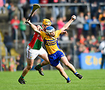 Tadgh Shanahan of Clooney-Quin in action against Aidan Quilligan of  Sixmilebridge during their senior county final replay at Cusack park. Photograph by John Kelly.
