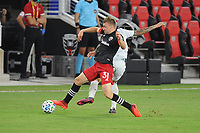 WASHINGTON, DC - AUGUST 25: Julian Gressel #31 of D.C. United battles for the ball with /Gustavo Bou #7 of New England Revolution during a game between New England Revolution and D.C. United at Audi Field on August 25, 2020 in Washington, DC.