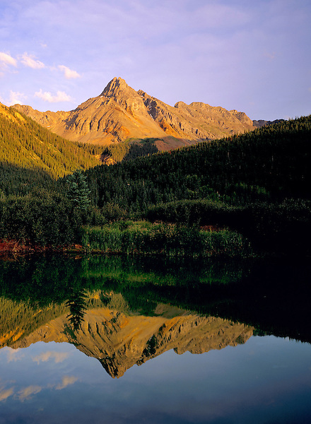 Pond  and Pilot Peak at sunset along Ophir Pass, San Juan Mountains, Telluride, Colorado, USA .  John leads wildflower photo tours into American Basin and throughout Colorado. All-year long.