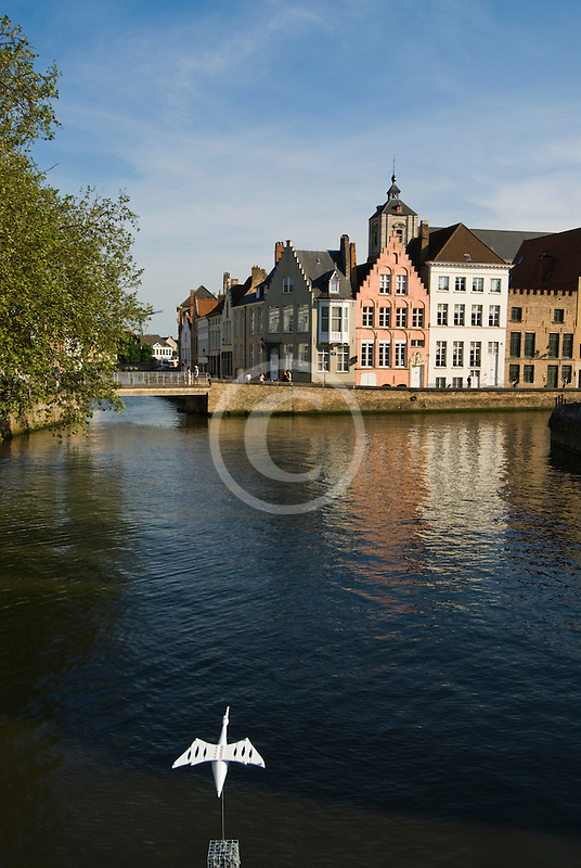 Belgium, Bruges, Canal and sculpture of white bird