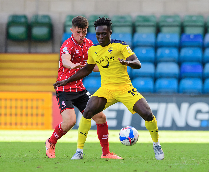 Lincoln City's Sean Roughan vies for possession with Oxford United's Daniel Agyei<br /> <br /> Photographer Chris Vaughan/CameraSport<br /> <br /> The EFL Sky Bet League One - Saturday 12th September 2020 - Lincoln City v Oxford United - LNER Stadium - Lincoln<br /> <br /> World Copyright © 2020 CameraSport. All rights reserved. 43 Linden Ave. Countesthorpe. Leicester. England. LE8 5PG - Tel: +44 (0) 116 277 4147 - admin@camerasport.com - www.camerasport.com - Lincoln City v Oxford United