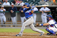 The Chattanooga  Lookouts catcher Hector Gimenez #30 swings at a pitch during  game one of the Southern League Northern Division Championship Series between the Chattanooga Lookouts and the Tennessee Smokies at Smokies Park on September 8, 2011 in Kodak, Tennessee.  The Smokies won the game 9-6.  (Tony Farlow/Four Seam Images)