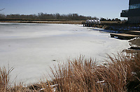 A sheet of ice covers Lake Bentonville, February 22, 2021 in Bentonville. Check out nwaonline.com/210223Daily/ for today's photo gallery. <br /> (NWA Democrat-Gazette/Charlie Kaijo)