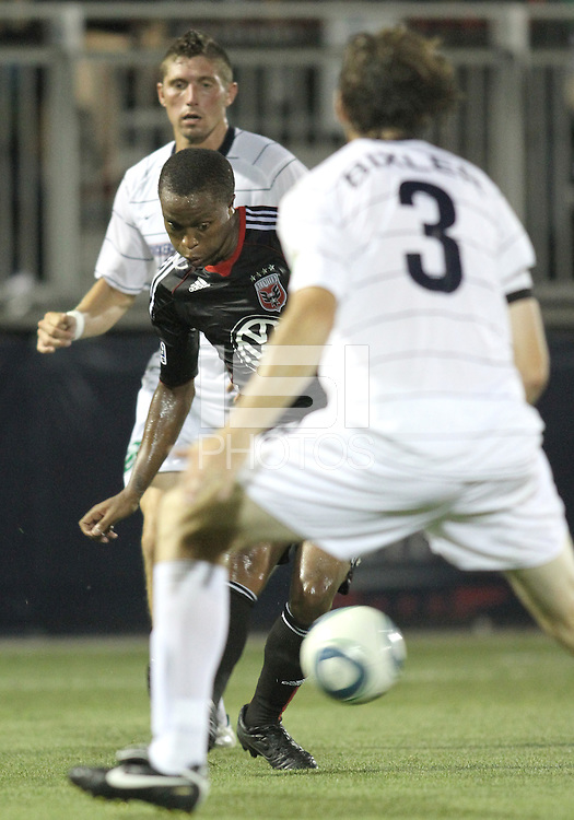 Boyzzz Khumalo #17 of D.C. United slips the ball past Dustin Bixler #3 of the Harrisburg City Islanders during a US Open Cup match at the Maryland Soccerplex on July 21 2010, in Boyds, Maryland. United won 2-0.