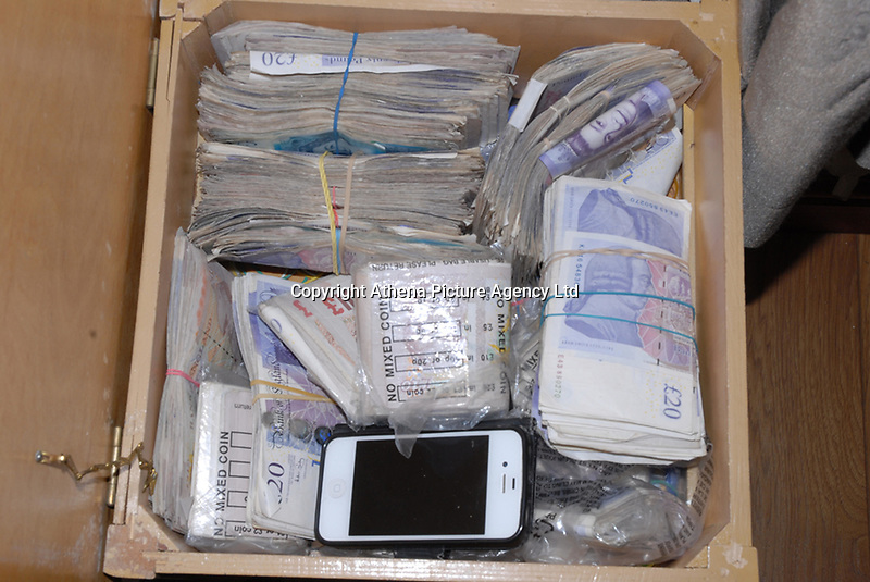 Pictured: Cash found as evidence<br /> Re: A drugs gang has been jailed for a total of sixty-two-and-a-half years after South Wales Police disrupted a drugs run from London to Cardiff and uncovered a sophisticated and lucrative criminal operation.<br /> Seven men were sentenced today after they were each convicted of being involved in the supply of Class A and B drugs at previous hearings at Cardiff Crown Court.<br /> The jury heard officers from the force's Organised Crime Unit confronted driver Stuart Jarman at Membury Services on the M4 on March 15th this year – and discovered 2kg of cocaine. Analysis of the Class A drug found it was 80% pure with a street value of £450,000.<br /> Jarman's arrest led officers to six other gang members – as well as a large-scale cannabis factory in Ammanford and another in Waunarlwyd, as well as an illegally-held live handgun.<br /> The following are today starting lengthy sentences after being convicted of conspiracy to supply Class A drugs:<br /> Stuart Jarman, 41, of Garden City, Rhymney, jailed for 6 years;<br /> Lec Gjoka, 42, of Greenwich, London, jailed for 14 years;<br /> Jason Theobald, 42, of Hill Street, Rhymney, jailed for 10 years;<br /> Lyndon Evans, 37, of Wind Street, Ammanford, jailed for nine years;<br /> John Knight, 36, of Pleasant Street, Pentre, jailed for 18 years.<br /> Evans and Knight had also admitted a separate charge of conspiring to supply cannabis, alongside Anthony Vobe, 41, of Garnant, Ammanford, who was jailed for three years for conspiracy to supply cannabis.<br /> A seventh defendant, Richard Phillips, 51, of Barnabas Close, Waunarlwydd, Swansea, was jailed for two-and-a-half years after he pleaded guilty to possessing a firearm whilst banned from doing so due to previous convictions, and conspiracy to produce cannabis. It was at his farm that officers located the firearm and one cannabis factory.<br /> The second cannabis factory was located in Ammanford and – at the time of being raided – had 