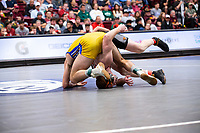 STANFORD, CA - March 7, 2020: Josh Loomer of Cal State Bakersfield and Colt Doyle of Oregon State University during the 2020 Pac-12 Wrestling Championships at Maples Pavilion.