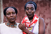 Lolgorian, Kenya. Two Maasai women, mother and daughter, who now live in town.