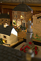 """08/12/16<br /> <br /> Cake Village<br /> <br /> In this incredibly detailed replica of a small Peak District village, everything is edible, from the baubles on the Christmas trees to the flowers around the houses and what's more the """"village"""" is made from 35 individual rich fruit Christmas cakes which will be eaten on the 25th!<br /> <br /> The amazing model village is made up of 18 shops and houses, which are all realistic reproductions of the actual buildings found in Youlgreave, and is open to the public to view at All Saints' church, the main focal point of the miniature masterpiece.<br /> <br /> Retired florist Lynn Nolan, who decorated all the cakes, came up with the original idea as a way of raising money for the church, which needs a new roof, and the first of the cakes went in the oven back in April.<br /> <br /> MORE...https://fstoppressblog.wordpress.com/the-village-thats-really-a-christmas-cake/<br /> <br /> All Rights Reserved F Stop Press Ltd. (0)1773 550665   www.fstoppress.com"""