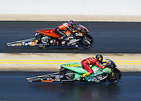 Sep 18, 2016; Concord, NC, USA; NHRA pro stock motorcycle rider Shawn Gann (near) races alongside Chip Ellis during the Carolina Nationals at zMax Dragway. Mandatory Credit: Mark J. Rebilas-USA TODAY Sports
