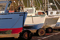 Fishing boats on pier, Port Orford has no protected harbor so boats are taken out of the water by a crane and stored on the pier. Port Orford Oregon USA.