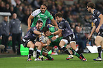 Osprey pair Martin Roberts and Tom Grabham haul down Connacht lock Quinn Roux.<br /> Guiness Pro12<br /> Ospreys v Connacht<br /> Liberty Stadium<br /> 31.10.14<br /> ©Steve Pope-SPORTINGWALES